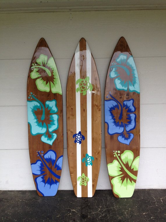 custom painted surfboards in a hawaiian theme